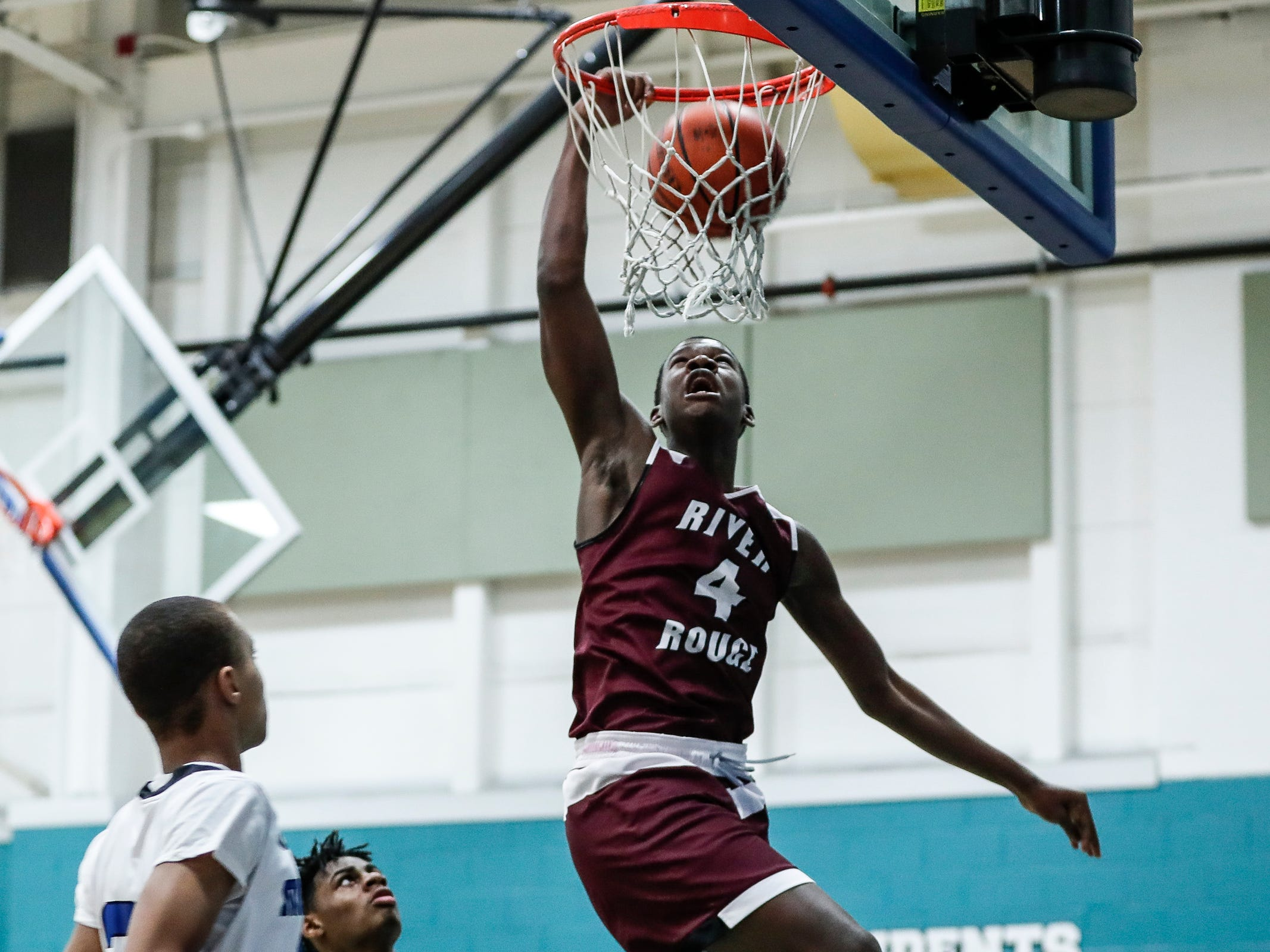 River Rouge small forward Legend Geeter (4) dunks against Henry Ford Academy: School for Creative Studies during first half at the A. Alfred Taubman Center For Design Education in Detroit, Tuesday, Jan. 8, 2019.