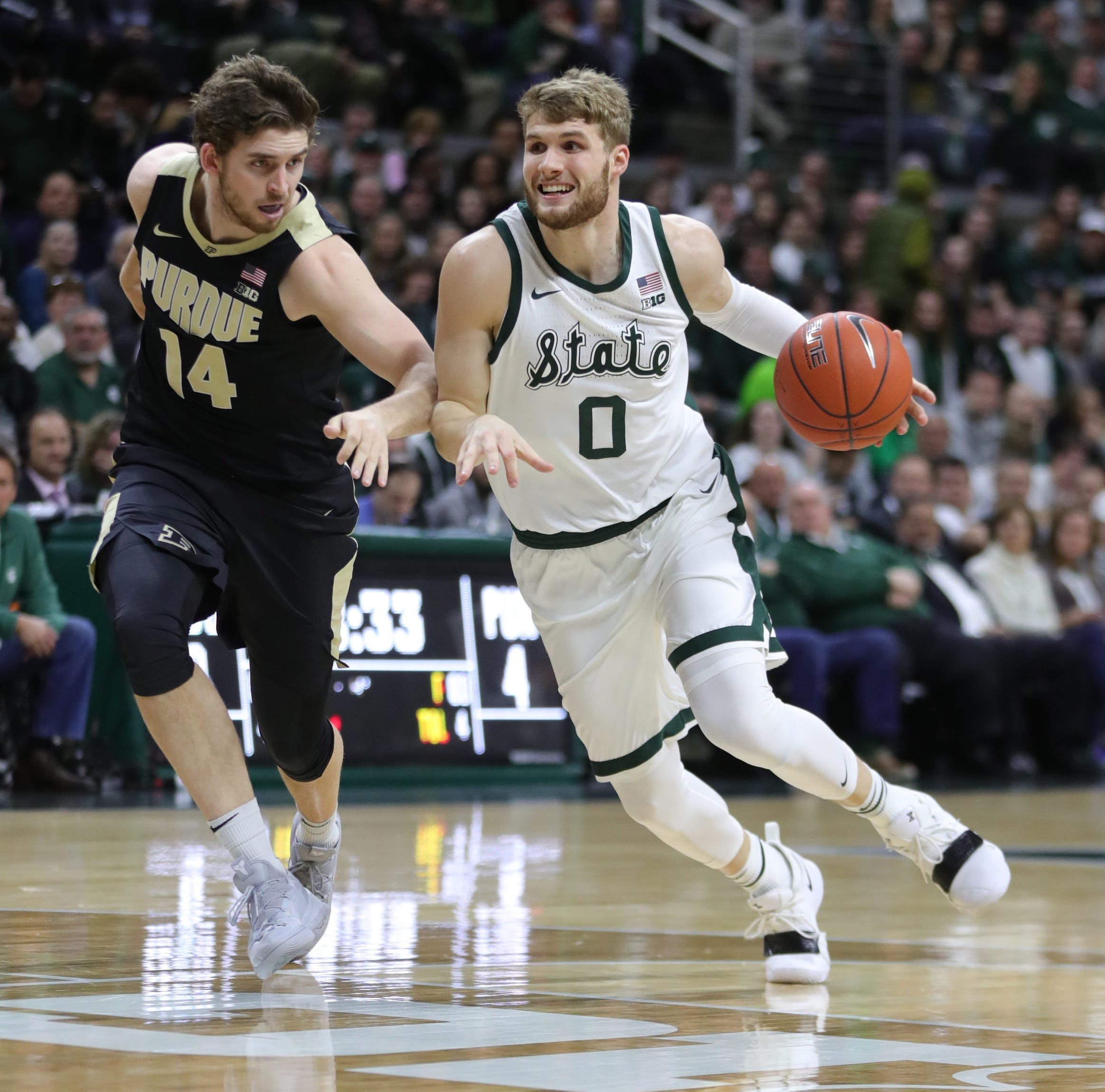 Michigan State's Kyle Ahrens dresses, Joshua Langford out vs. Maryland