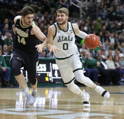 26d2b13f9ddd Michigan State guard Kyle Ahrens drives against Purdue guard Ryan Cline  during first half action Tuesday