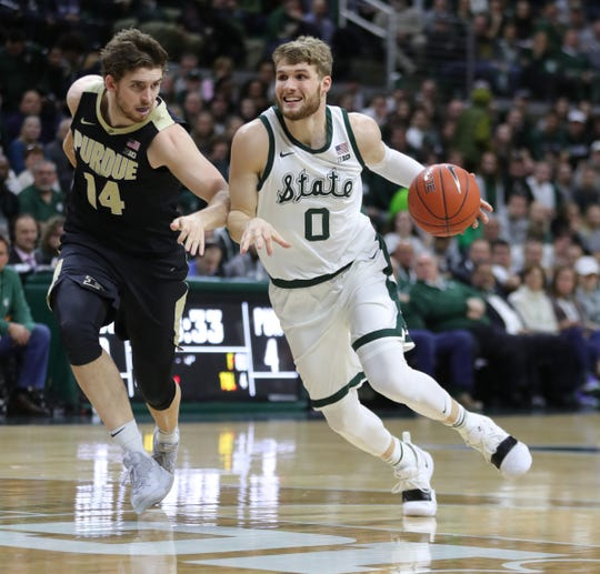 Michigan State guard Kyle Ahrens drives against Purdue guard Ryan Cline during first half action Tuesday, Jan. 8, 2019 at the Breslin Center in East Lansing, Mich.