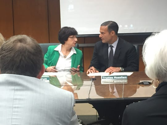 New Michigan State University board chairwoman Dianne Byrum talks to board member Brian Mosallam at a recent board meeting