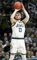 Michigan State guard Kyle Ahrens scores against Purdue during first half action Tuesday, Jan. 8, 2019 at the Breslin Center in East Lansing, Mich.