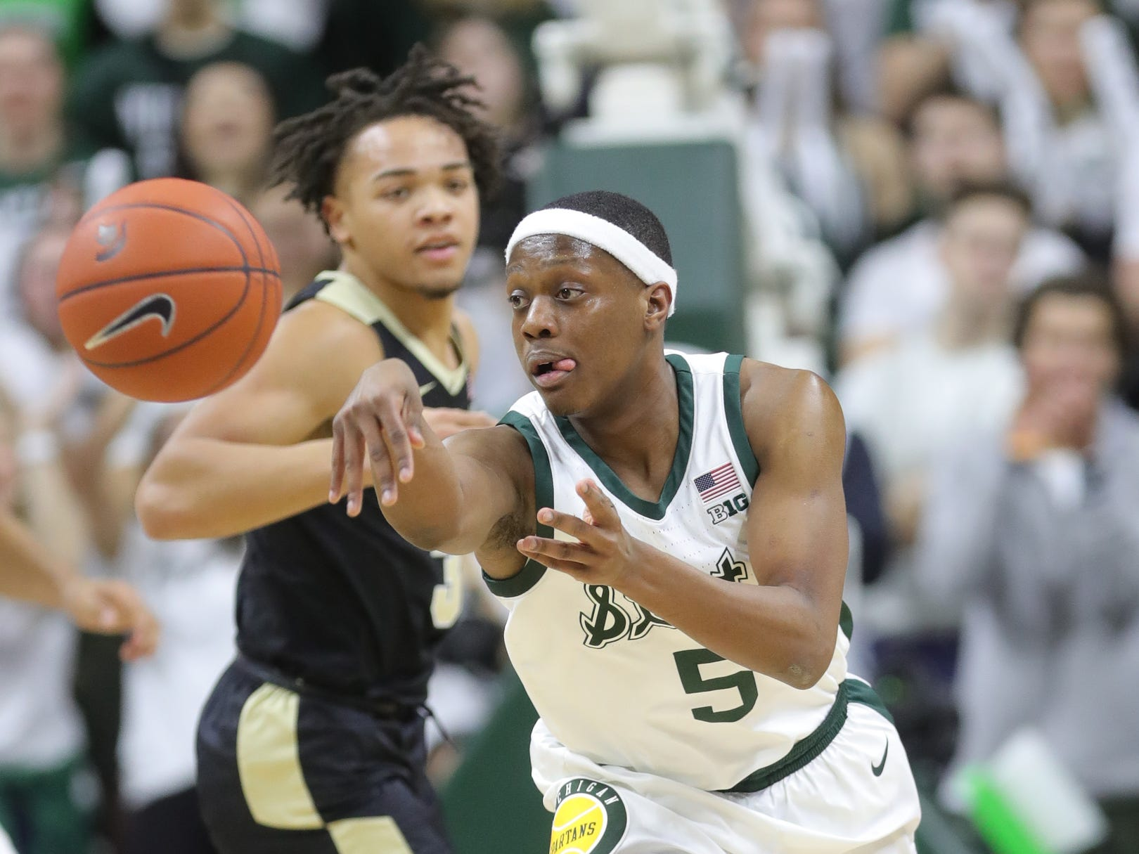 Michigan State guard Cassius Winston steals the ball from Purdue guard Carsen Edwards during first half action Tuesday, Jan. 8, 2019 at the Breslin Center in East Lansing, Mich.