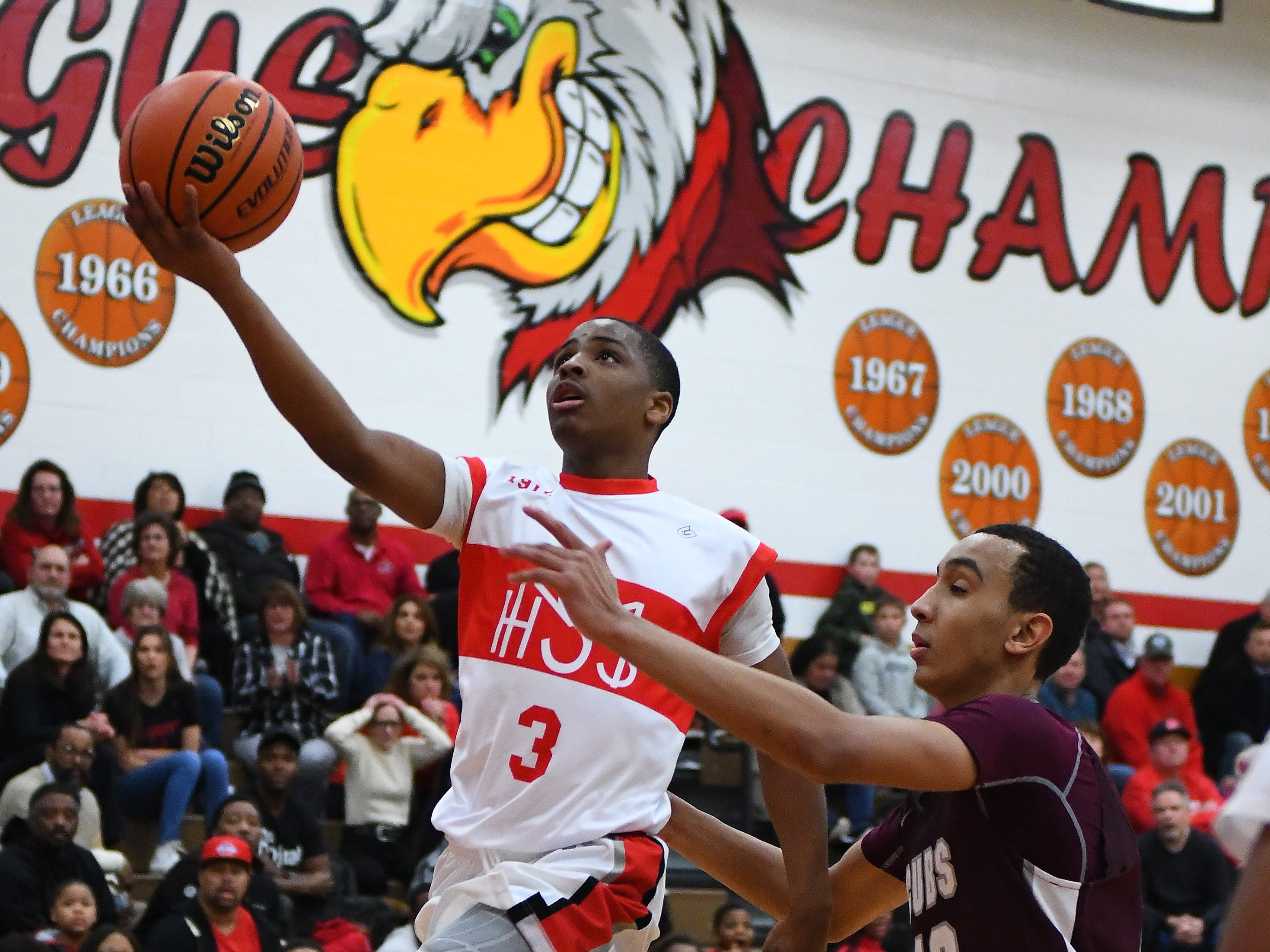 Kareem Rozier of Orchard Lake St. Mary's drives to the hoop against U-D Jesuit's J.T. Morgan in the second half.