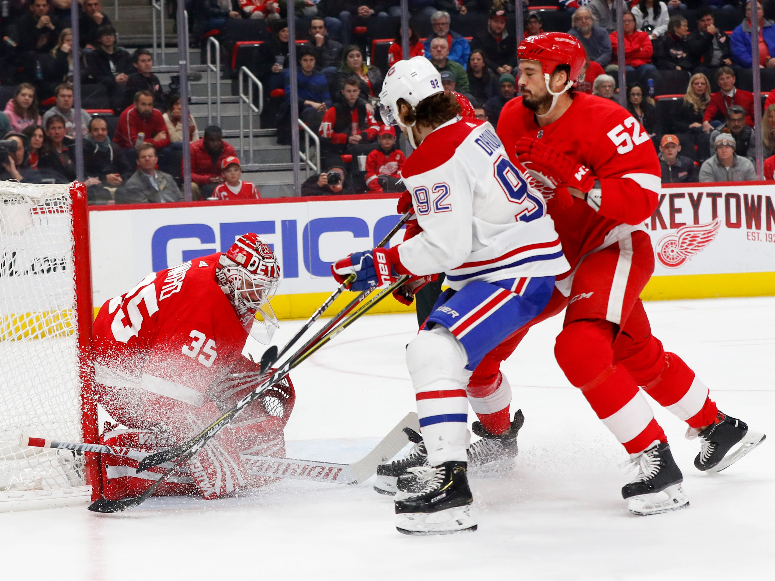 Detroit Red Wings goaltender Jimmy Howard (35) stops a Montreal Canadiens left wing Jonathan Drouin (92) shot in the first period.