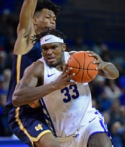 Forward Nick Perkins, who's from Milan, is averaging 13.9 points and 8.1 rebounds for Buffalo this season.