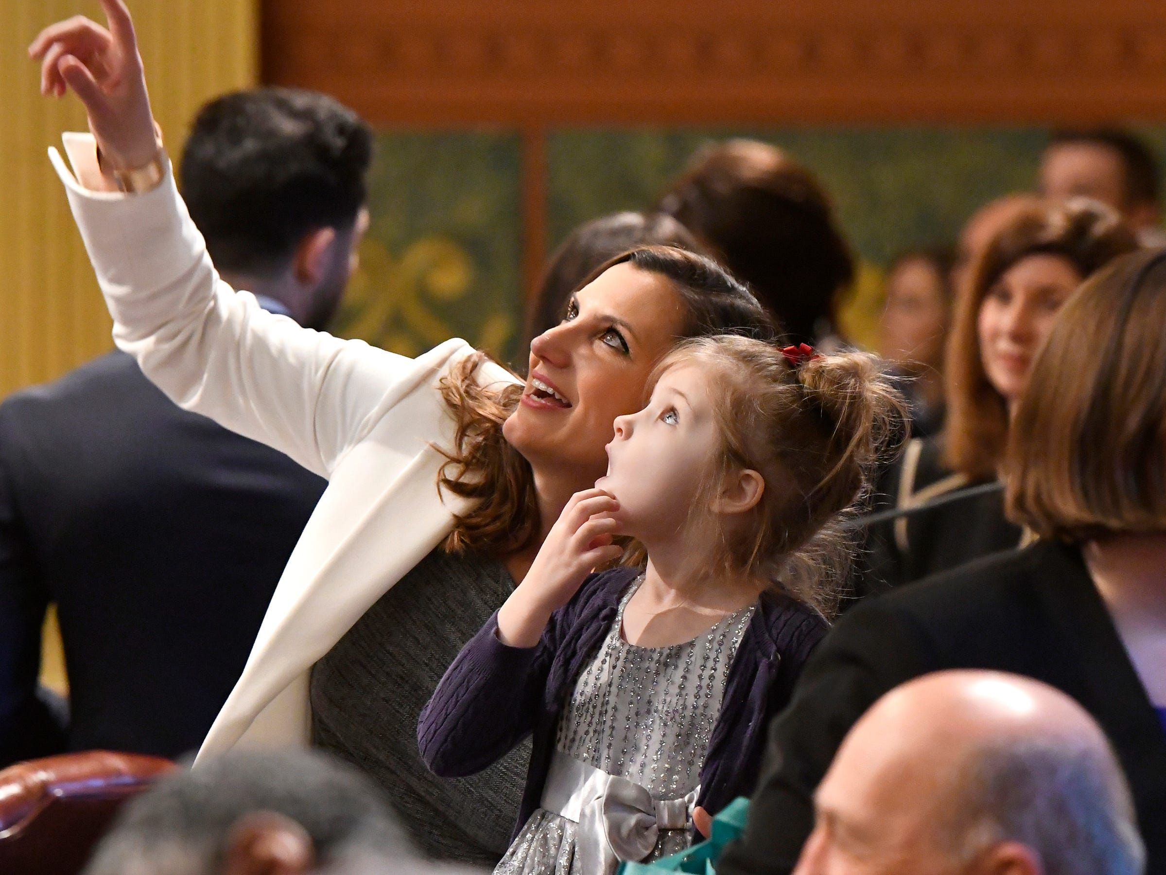 Rep. Kristy Pagan, D-Canton, shows niece Evelyn, 5, around the House chambers before the opening ceremonies for the 100th Legislature.
