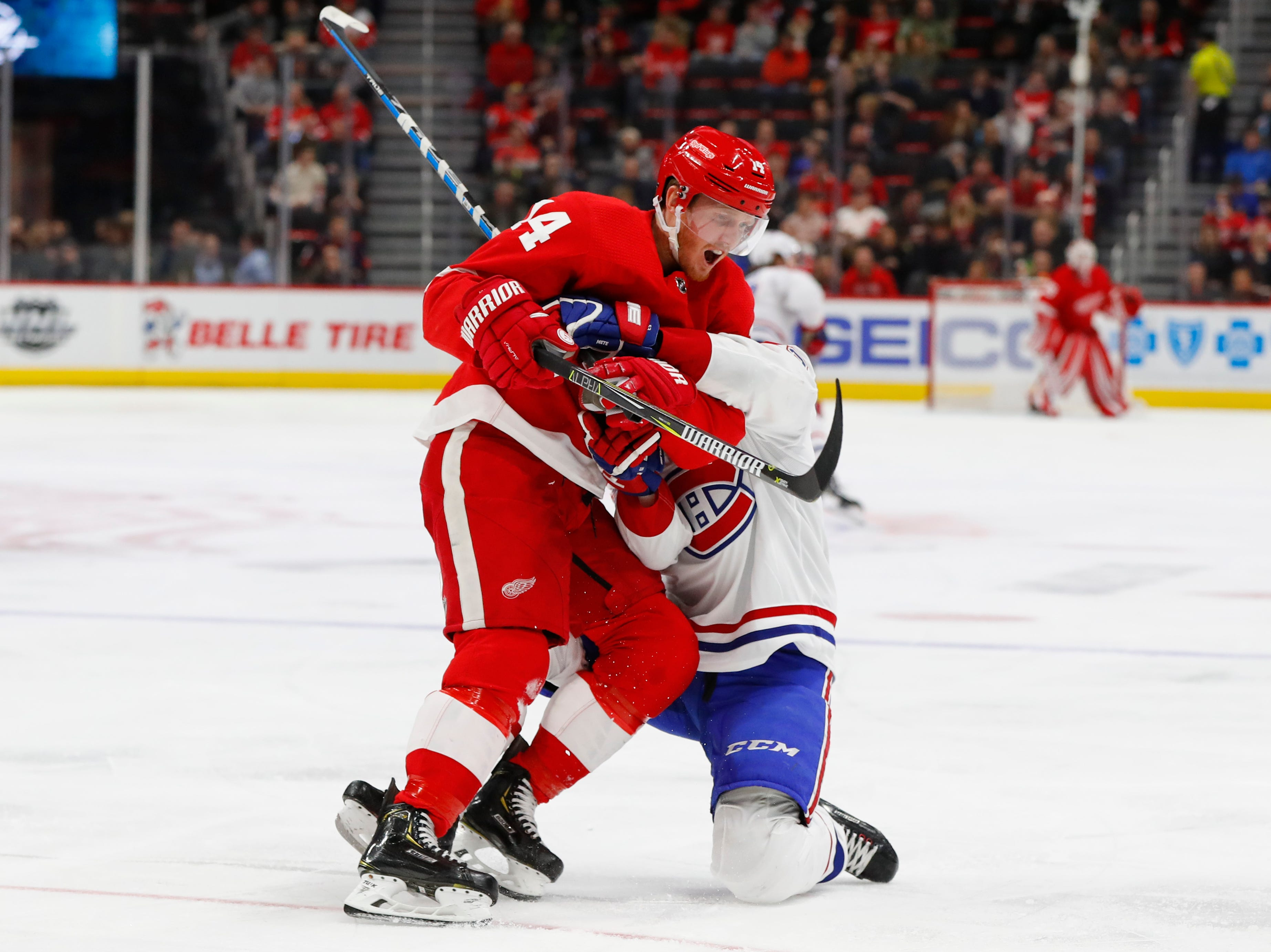 Montreal Canadiens defenseman Victor Mete (53) wraps Detroit Red Wings right wing Gustav Nyquist (14) up in the second period.