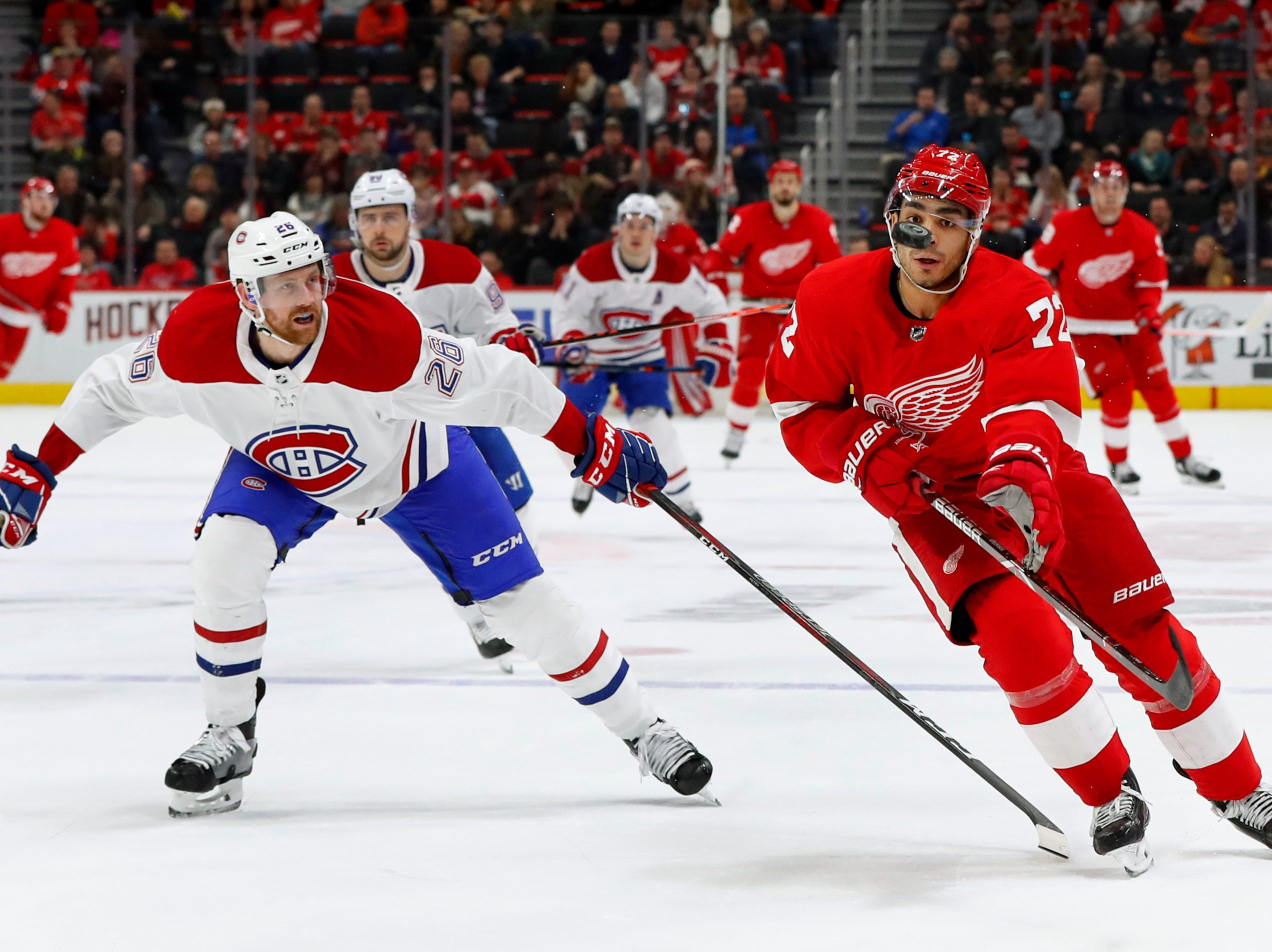Detroit Red Wings center Andreas Athanasiou (72) keeps his eyes on the puck as Montreal Canadiens defenseman Mike Reilly (28) defends in the second period.