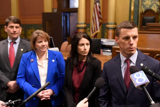 Rep. David LaGrand, left, House Democratic Leader Christine Greig, Attorney General Dana Nessel, and House Speaker Lee Chatfield speak to the media after the opening ceremonies.