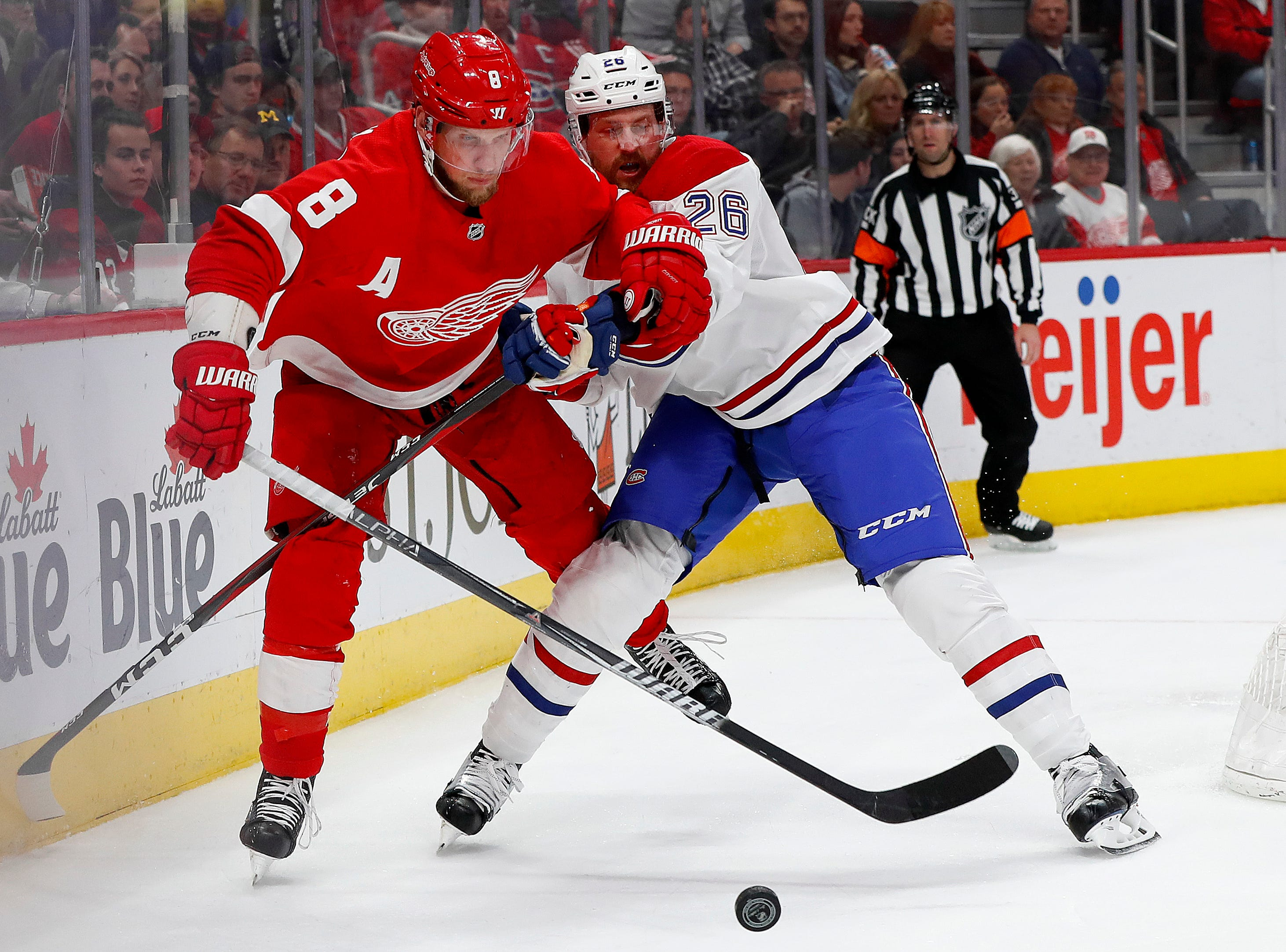 Detroit Red Wings left wing Justin Abdelkader (8) and Montreal Canadiens defenseman Jeff Petry (26) battle for the puck in the second period.