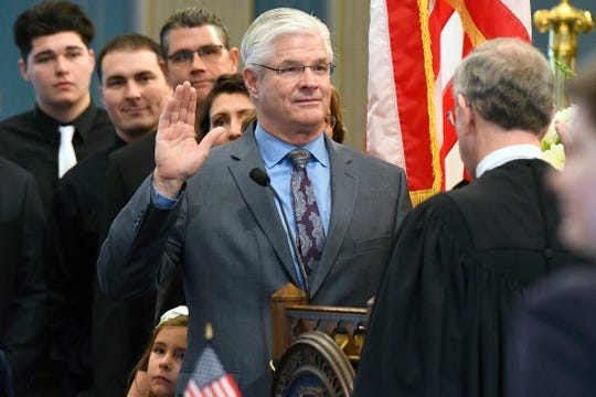 Sen. Mike Shirkey, R-Clark Lake,  is sworn in by Chief Justice Stephen Markman.