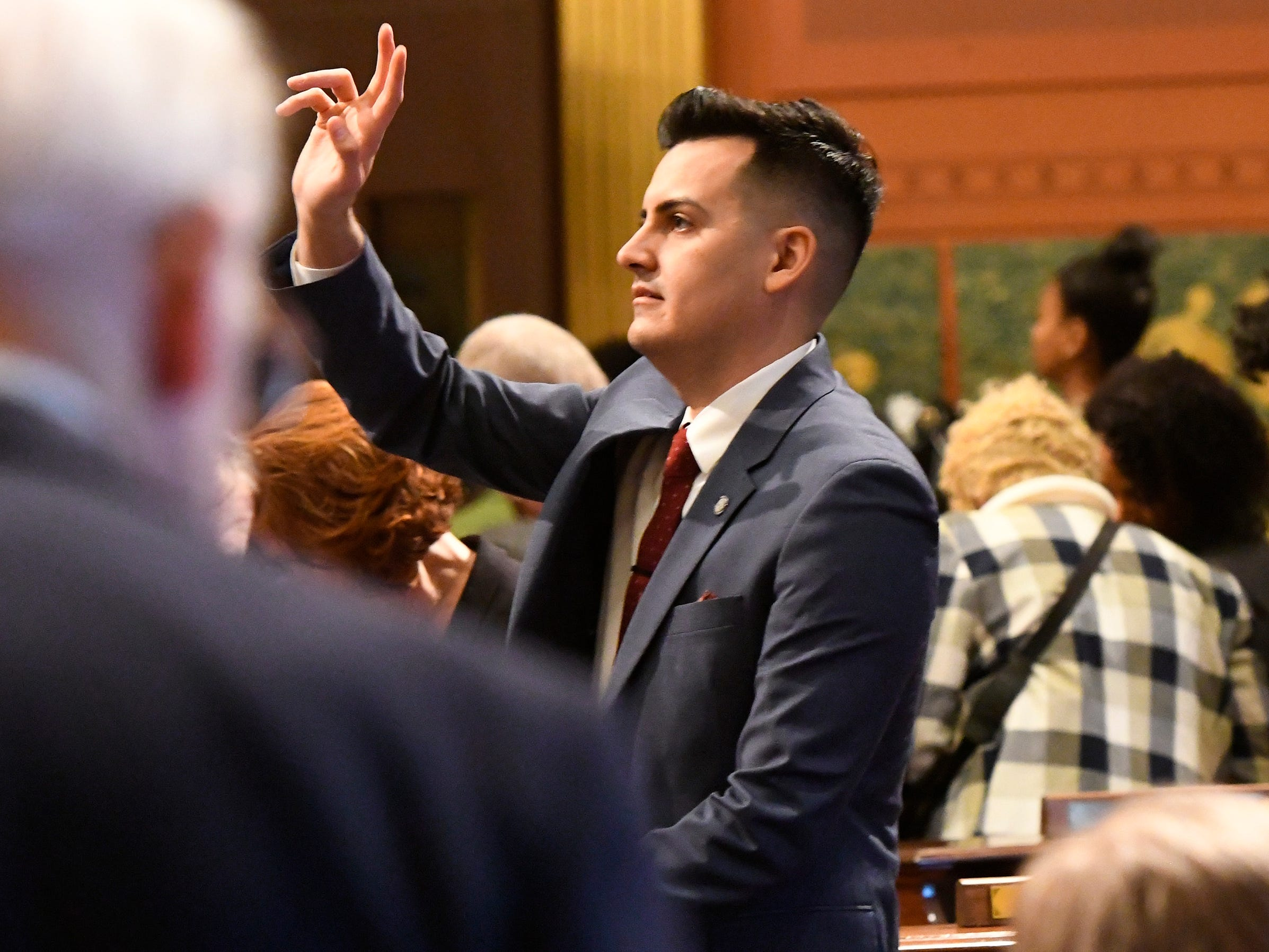 Rep. Darrin Camilleri, D-Brownston, waves to spectators from the floor.