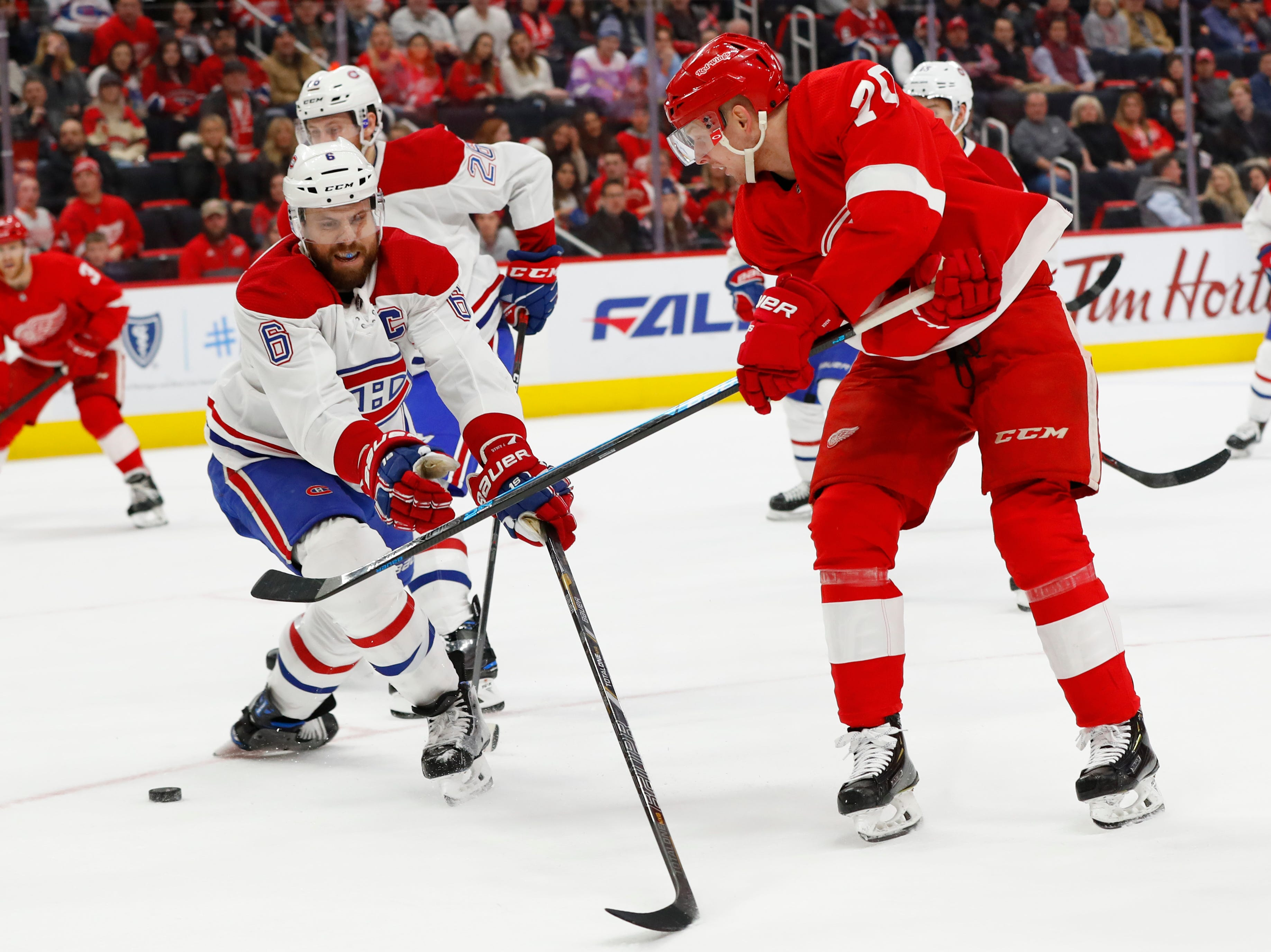 Detroit Red Wings center Christoffer Ehn (70) shoots as Montreal Canadiens defenseman Shea Weber (6) defends in the second period.