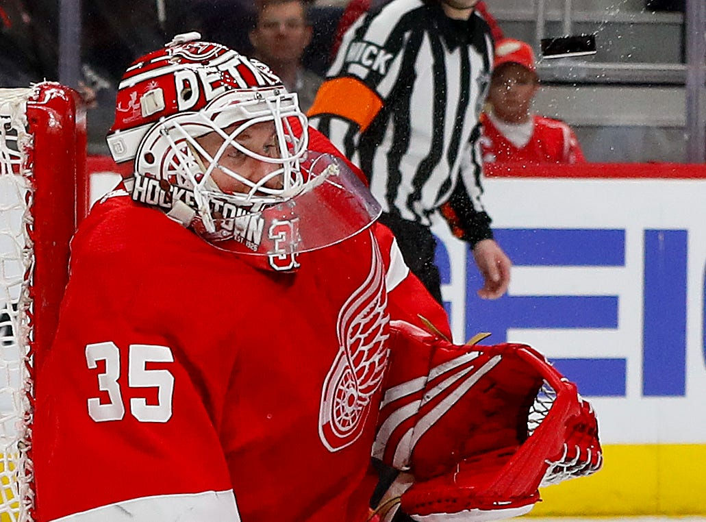 Detroit Red Wings goaltender Jimmy Howard (35) stops a Montreal Canadiens shot in the first period.