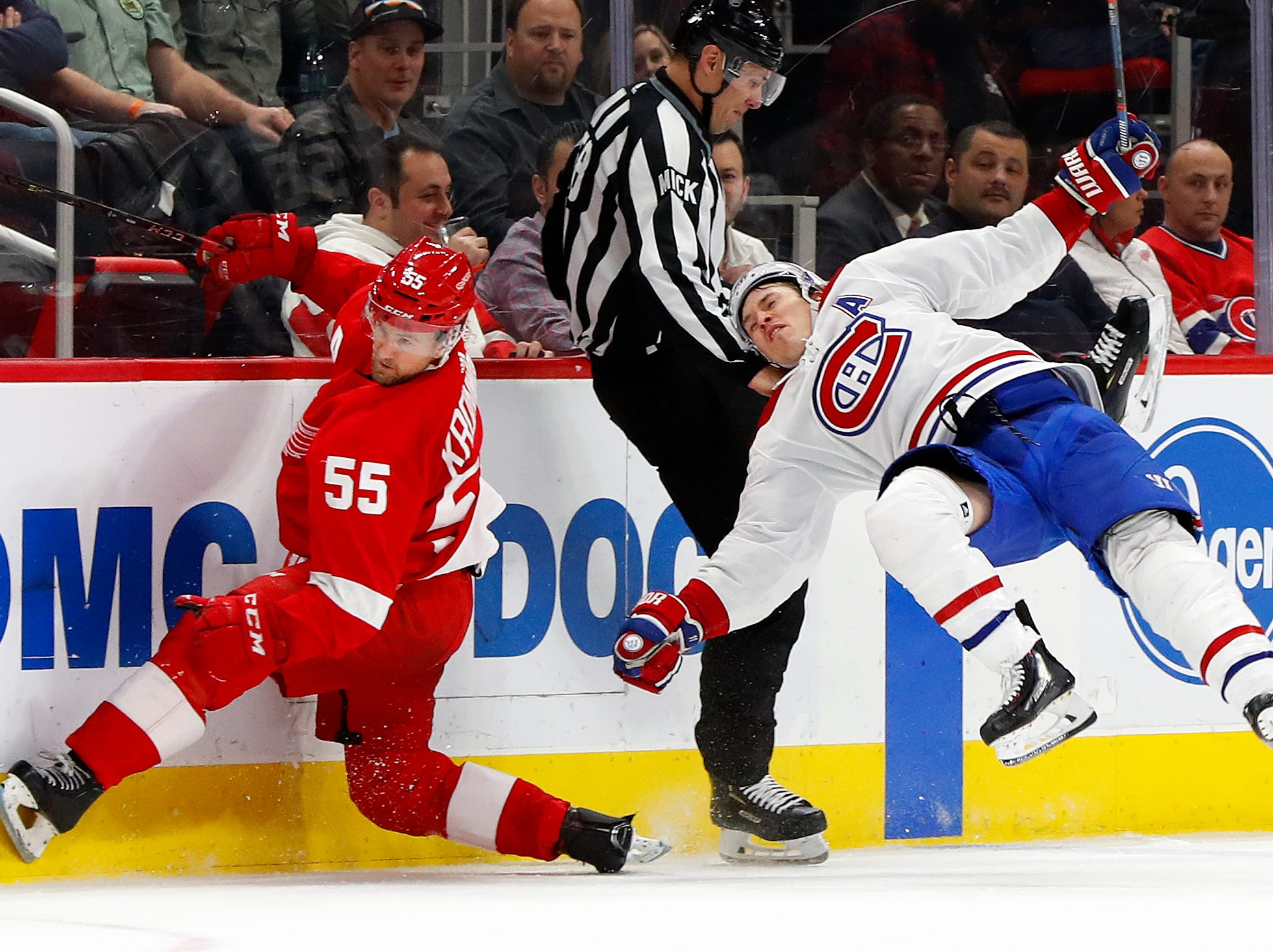 Detroit Red Wings defenseman Niklas Kronwall (55) checks Montreal Canadiens right wing Brendan Gallagher (11) in the third period.