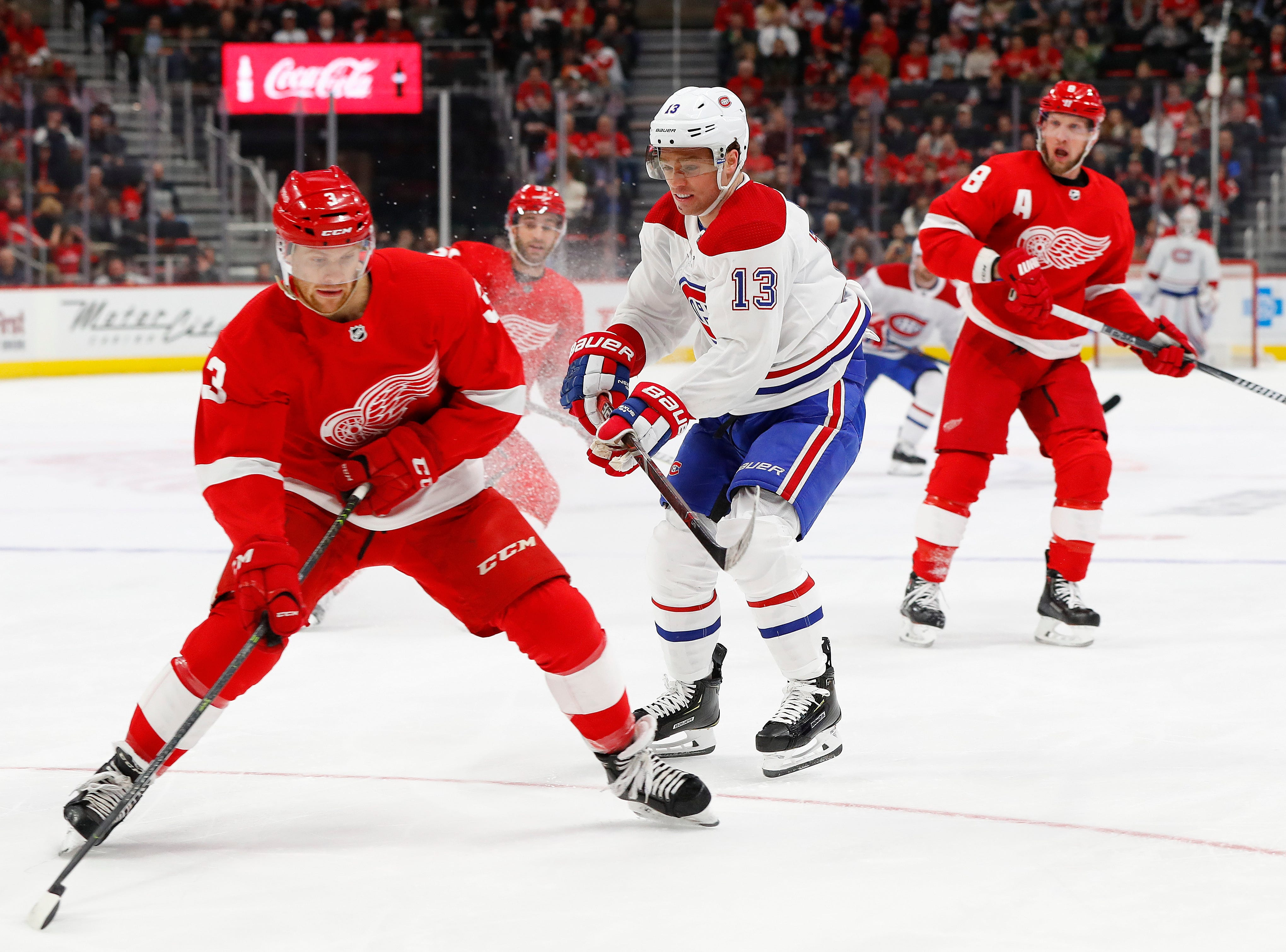 Detroit Red Wings defenseman Nick Jensen (3) protects the puck from Montreal Canadiens center Max Domi (13) in the first period.