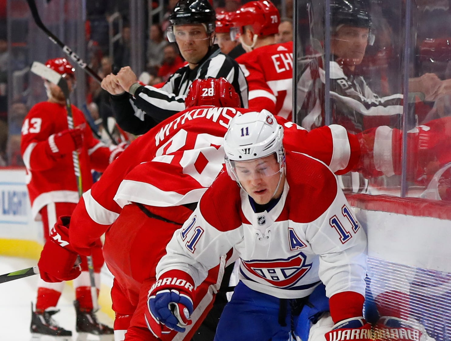 Montreal Canadiens right wing Brendan Gallagher (11) avoids the check of Detroit Red Wings right wing Luke Witkowski (28) in the first period.