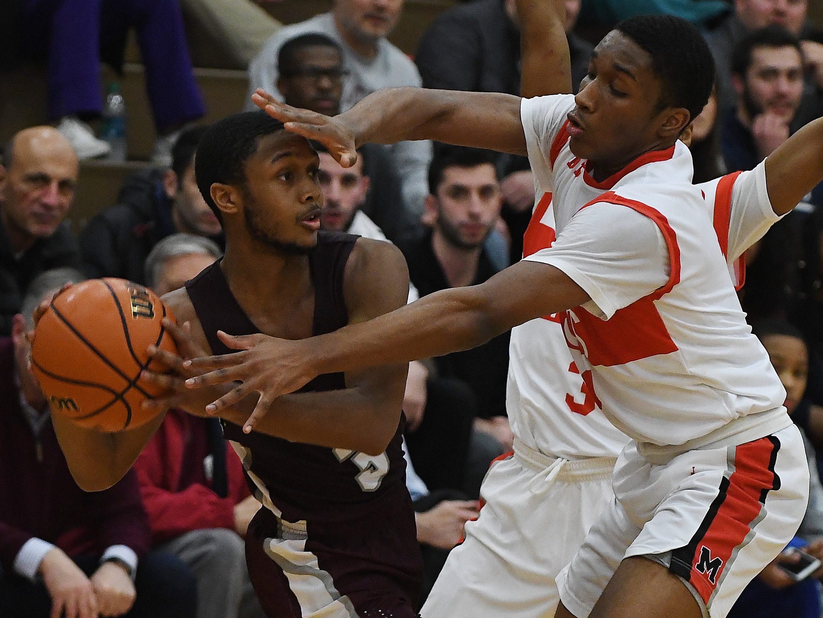 U-D Jesuit's Jordan Montgomery feels some full court defense pressure rom Kareem Rozier and Lorne Bowman II of Orchard Lake St. Mary's in the second half.