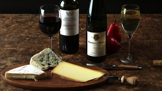 Frappato and riesling are two grapes that pair well with a variety of cheeses. From Sicily, try Marchese Montefusco Frappato, left. From the Finger Lakes, try Dr. Konstantin Frank Riesling. (E. Jason Wambsgans/Chicago Tribune/TNS)