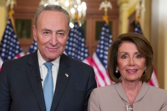 Senate Minority Leader Chuck Schumer of N.Y., and House Speaker Nancy Pelosi of Calif.,  after speaking on Capitol Hill in response President Donald Trump's address, Tuesday.