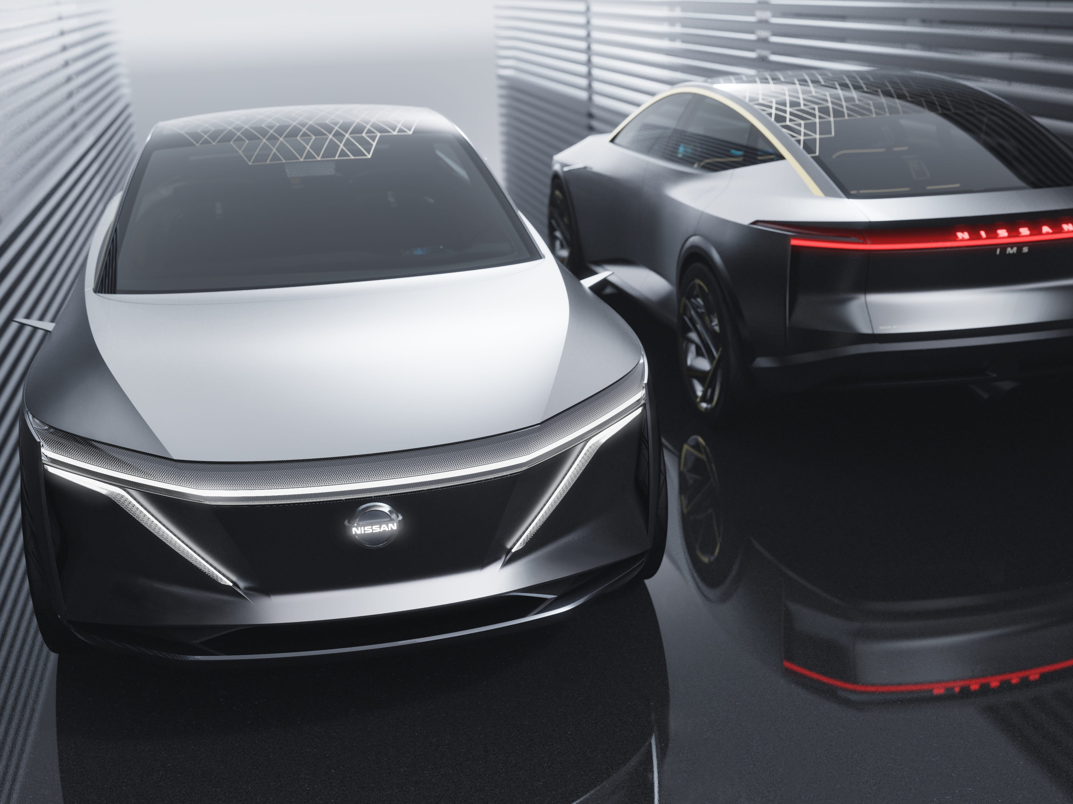 "The Nissan IMs all-wheel-drive electric concept vehicle.  ""In autonomous driving mode, the IMs' headlights and rear combination light turn blue and the lighting blinks continuously on the center of the front and rear to notify pedestrians and other drivers of its autonomous status."""