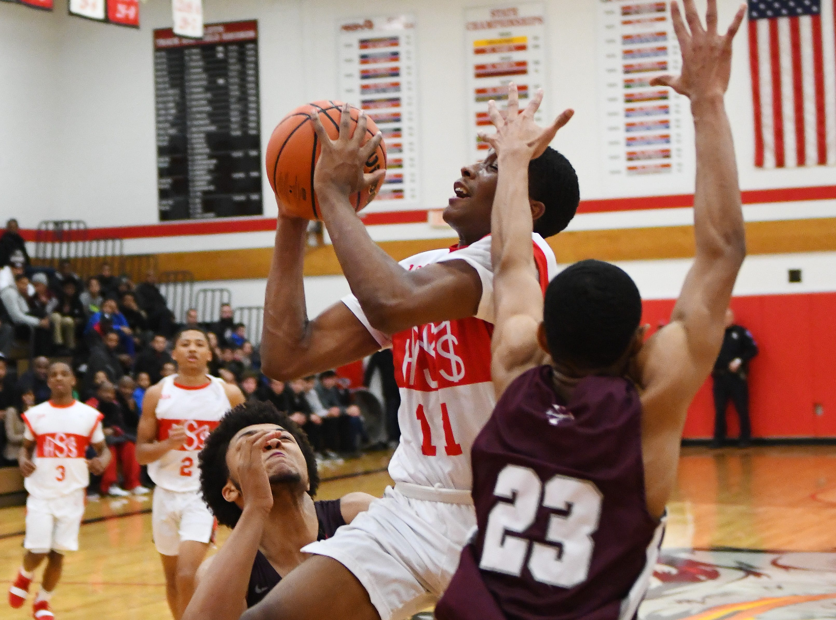 Lorne Bowman II of Orchard Lake St. Mary's drives through  U-D Jesuit's Daniel Friday and JonMarcus Roland in the second half.