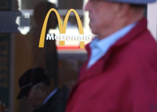 A pedestrian walks by a McDonald's restaurant on January 30, 2018 in San Francisco, California.