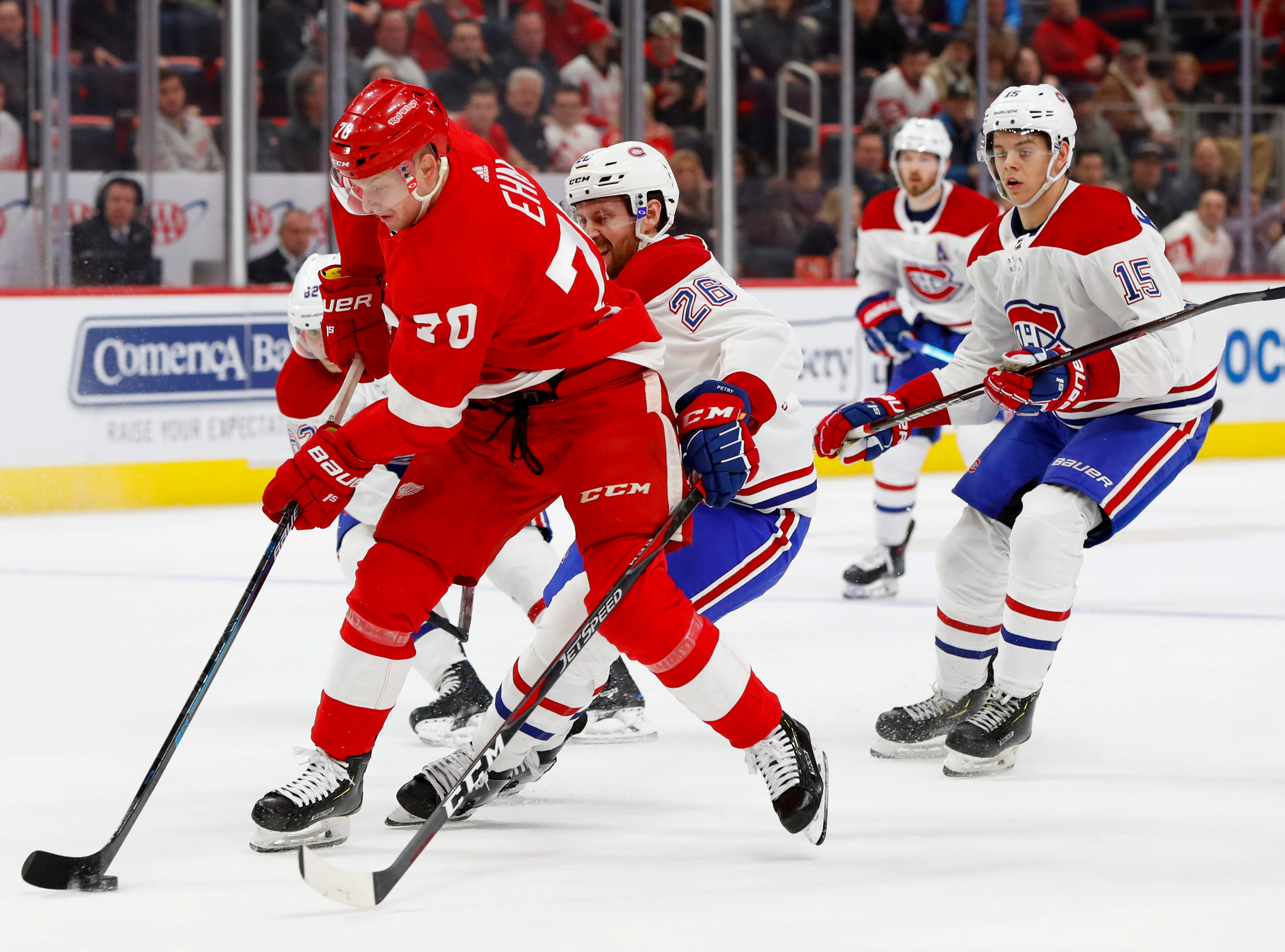 Detroit Red Wings center Christoffer Ehn (70) skates with the puck as Montreal Canadiens defenseman Jeff Petry (26) defends in the second period.