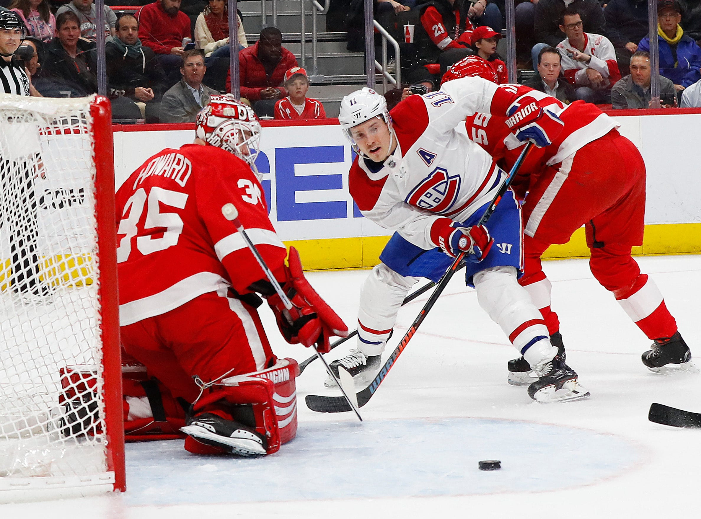 Detroit Red Wings goaltender Jimmy Howard (35) deflects a shot by Montreal Canadiens right wing Brendan Gallagher (11) in the first period.