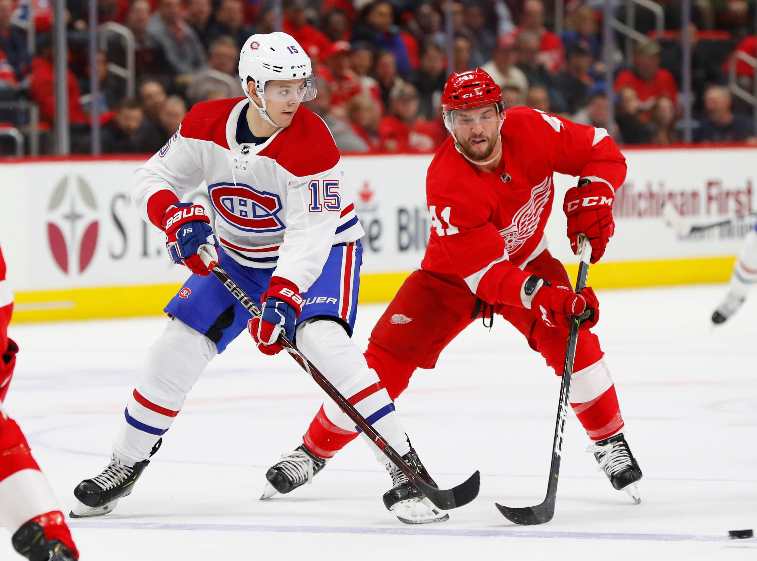 Montreal Canadiens center Jesperi Kotkaniemi (15) passes as Detroit Red Wings center Luke Glendening (41) defends in the first period.