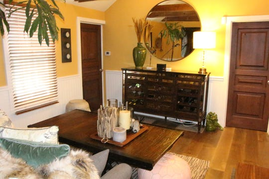 The same living room with affordable beadboard added and new hardwood flooring. (Design Recipes/TNS)