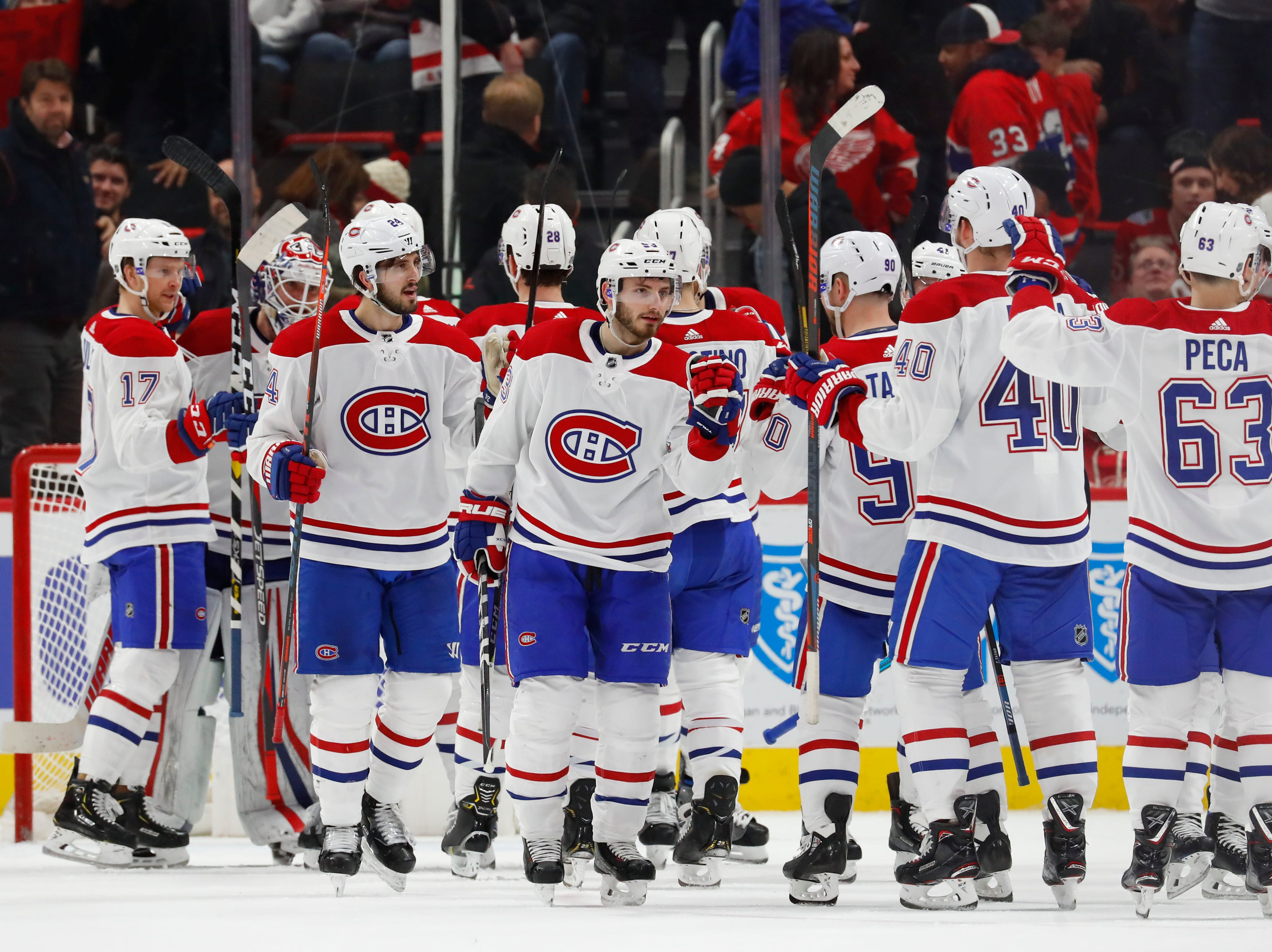 Montreal Canadiens players celebrate their 3-2 win against the Detroit Red Wings.