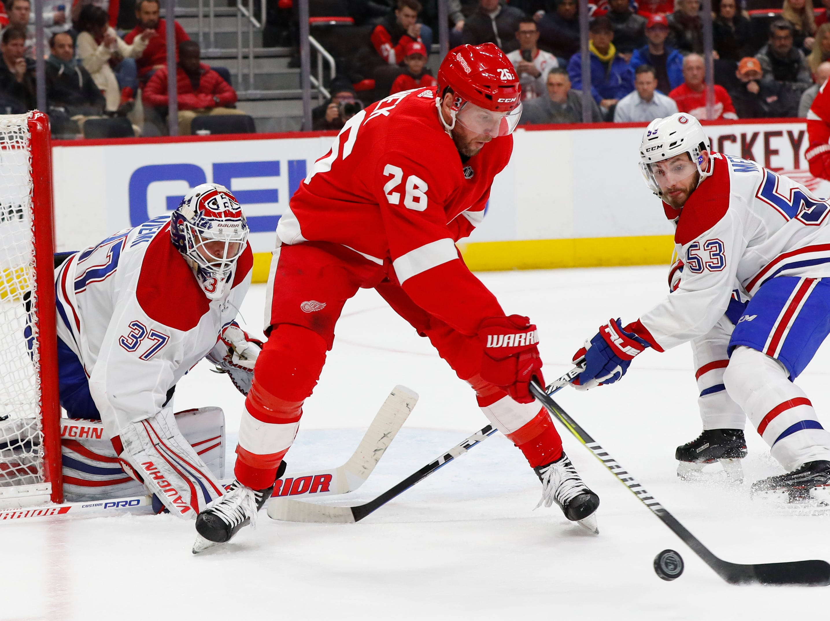 Detroit Red Wings left wing Thomas Vanek (26) controls the puck in front of Montreal Canadiens goaltender Antti Niemi (37) as Victor Mete (53) defends in the second period.