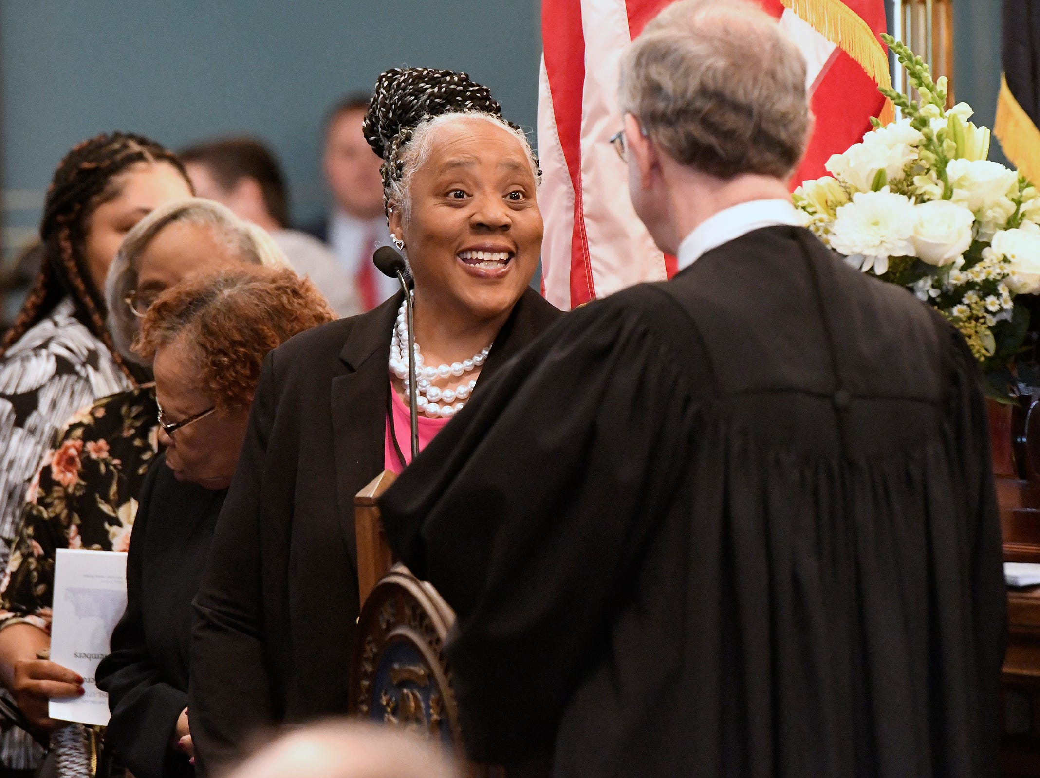 New State Sen. Betty Jean Alexander laughs with Chief Justice Stephen Markman before swearing in ceremonies.