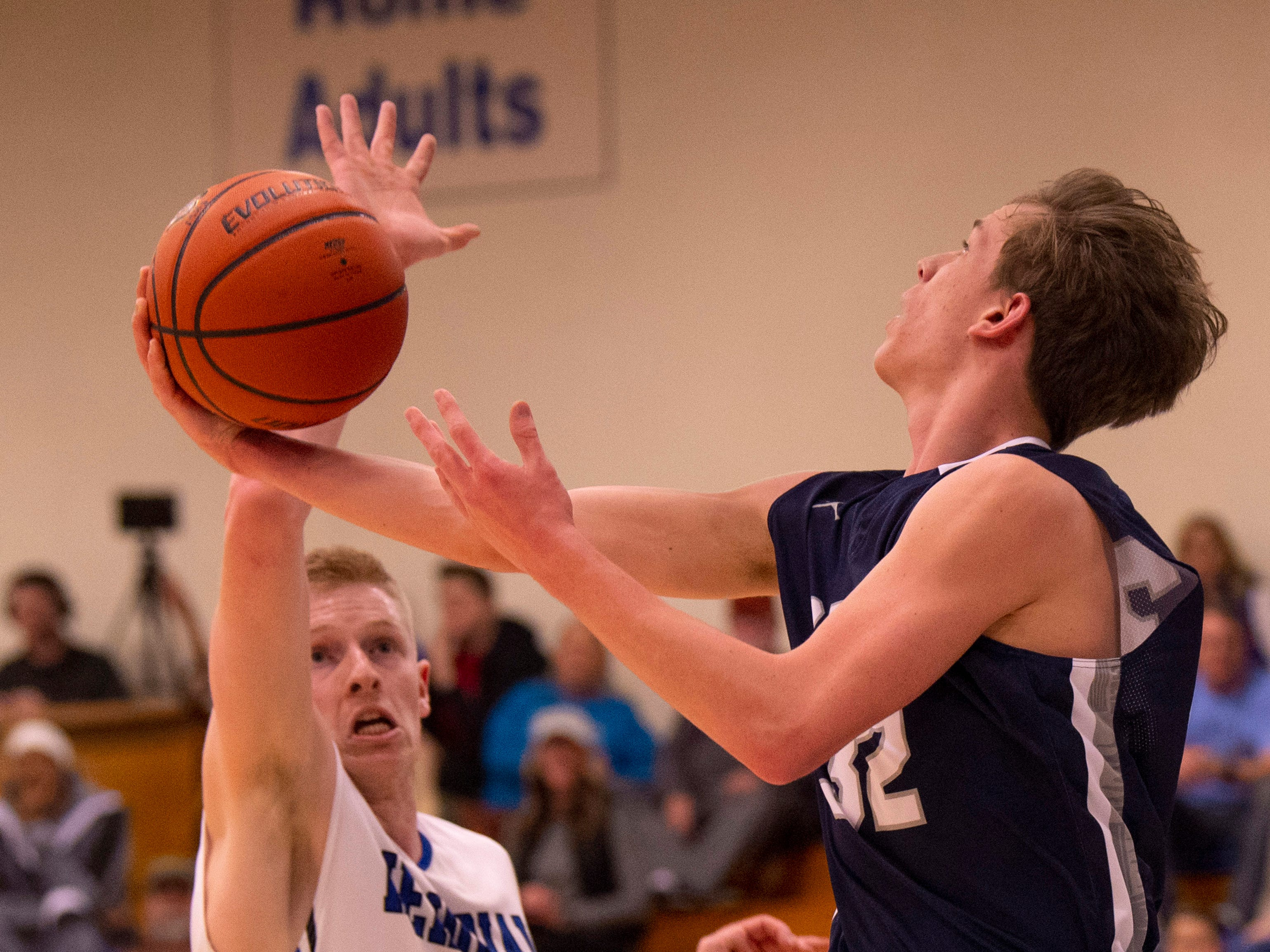 Memorial's Sam DeVault (41) tries to block the shot of Reitz's Ethan Higgs (32) in the first round of the SIAC Tournament at Memorial High School Tuesday night.