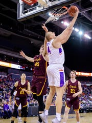 University of Evansville's Dainius Charkevicius (14) blasts past Loyola's Cameron Krutwig (25) to the net in the first half at Ford Center in Evansville, Ind., Tuesday, Jan. 8, 2019. The Purple Aces rolled over the Ramblers, 67-48.