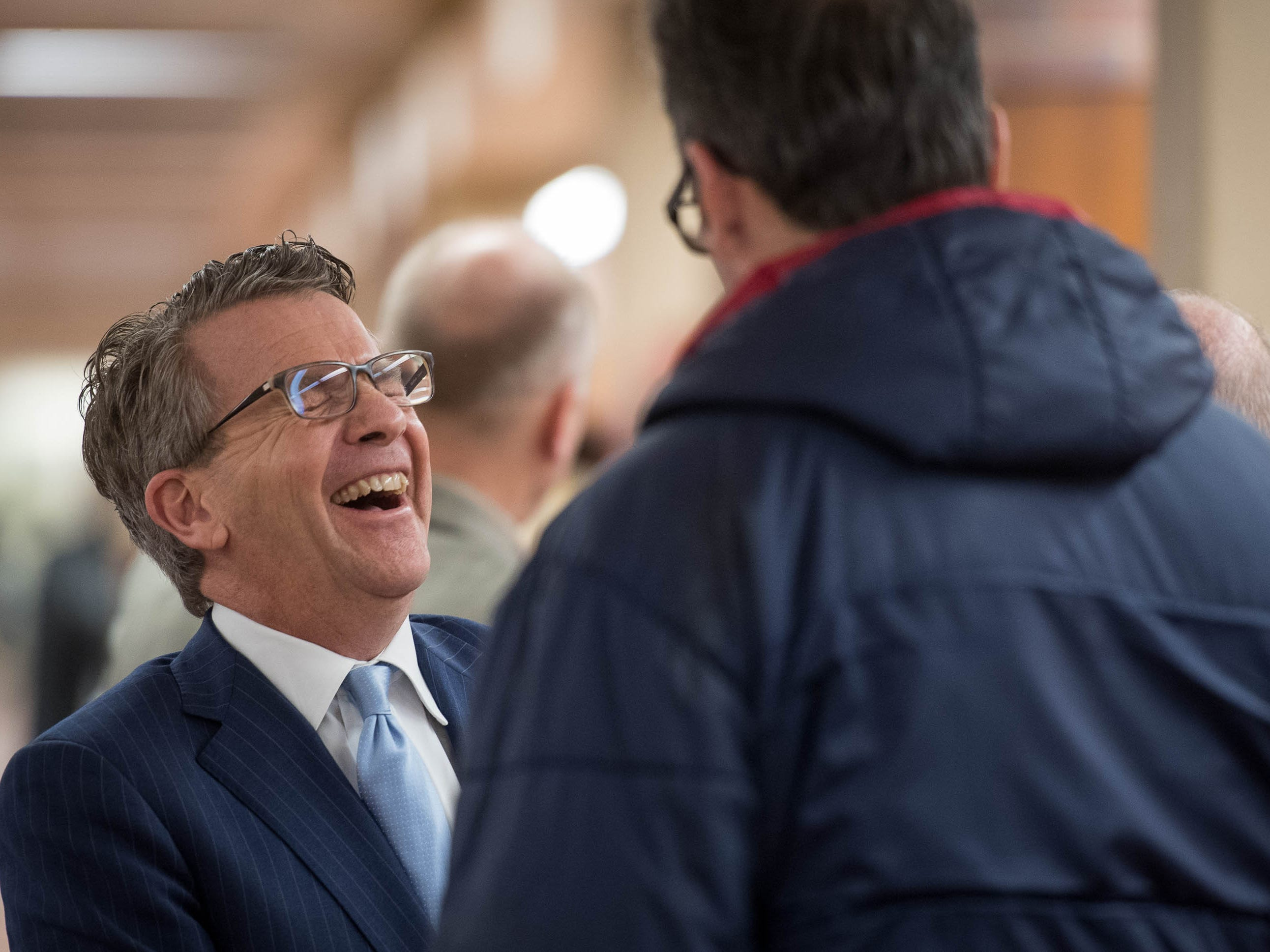 Evansville Mayor Lloyd Winnecke shares a laugh as he works his way through a gauntlet of supporters as he files for re-election at the Vanderburgh County Election Office Wednesday, January 9, 2019.