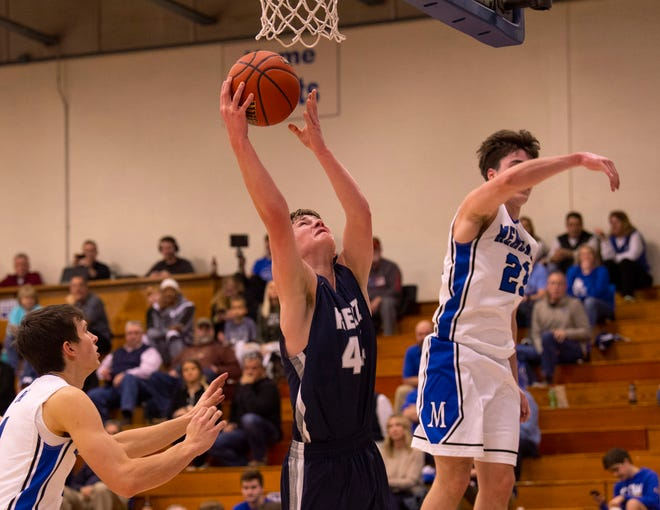 Reitz's Gavin Schippert (44) goes reverse against Memorial in the first round of the SIAC Tournament at Memorial High School Tuesday night.