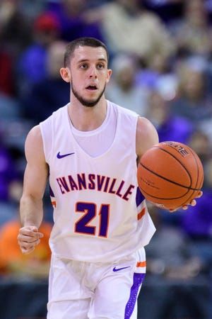 University of Evansville's Shea Feehan (21) dribbles down the court in the first half against the Loyola Ramblers at Ford Center in Evansville, Ind., Tuesday, Jan. 8, 2019. The Purple Aces rolled over the Ramblers, 67-48.