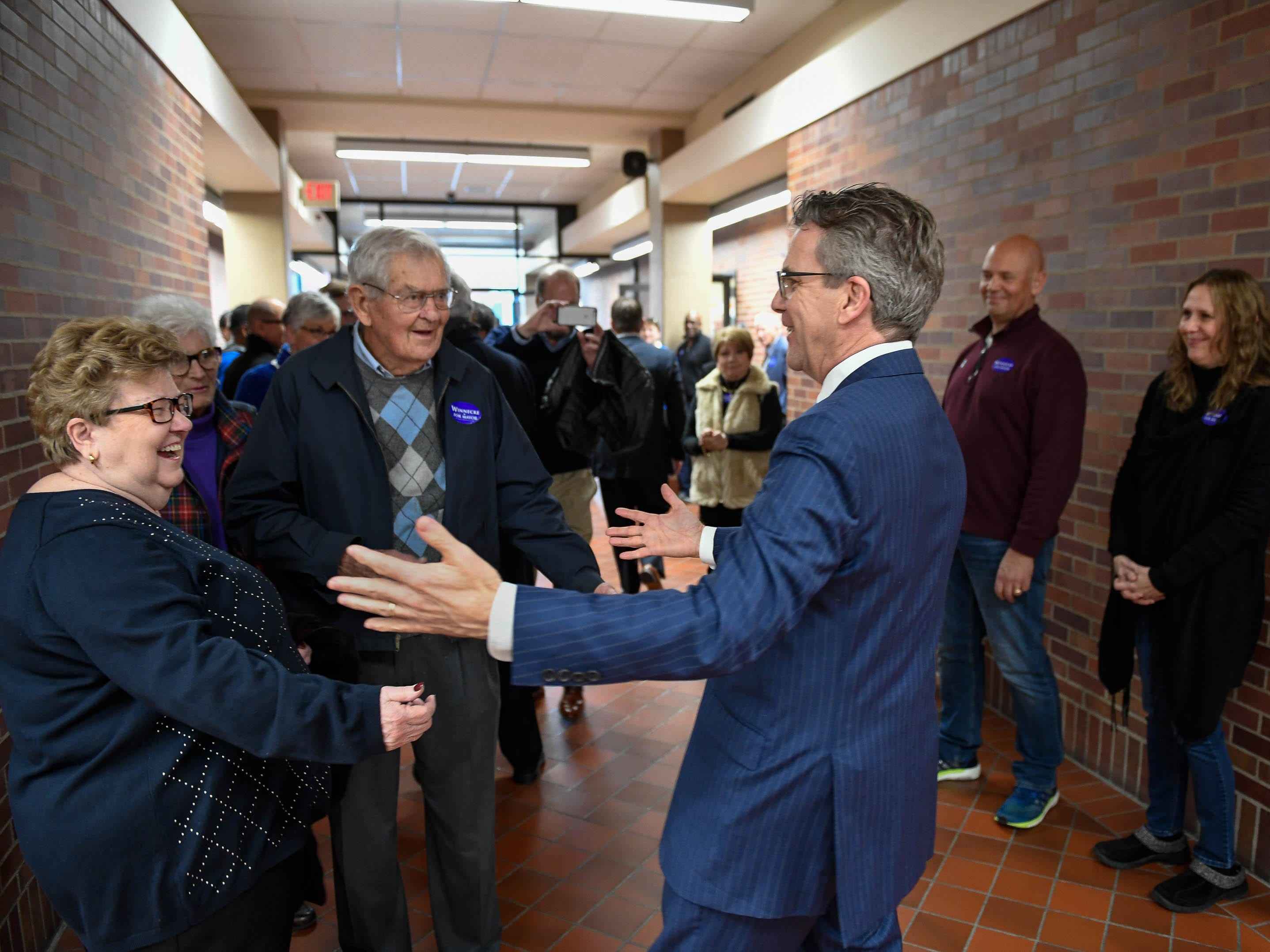 Evansville Mayor Lloyd Winnecke greets supporters as he files for re-election Wednesday at the Civic Center Election Officer, January 9, 2019.
