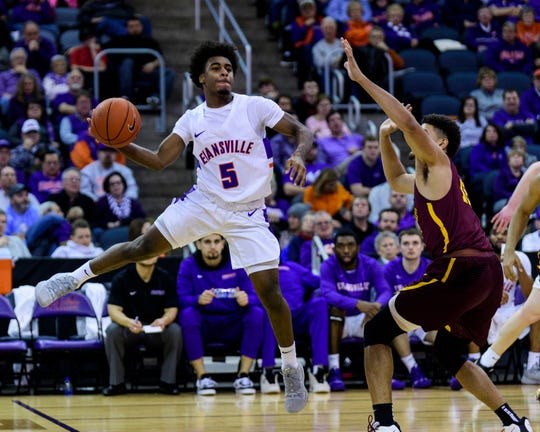 University of Evansville's Shamar Givance (5) makes a dynamic pass against the Loyola Ramblers at Ford Center in Evansville, Ind., Tuesday, Jan. 8, 2019. The Purple Aces rolled over the Ramblers, 67-48.