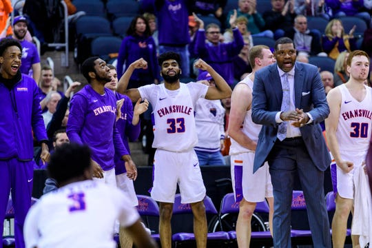 The University of Evansville Purple Aces react to their team racking up more points against the Loyola Ramblers at Ford Center in Evansville, Ind., Tuesday, Jan. 8, 2019. The Purple Aces rolled over the Ramblers, 67-48.