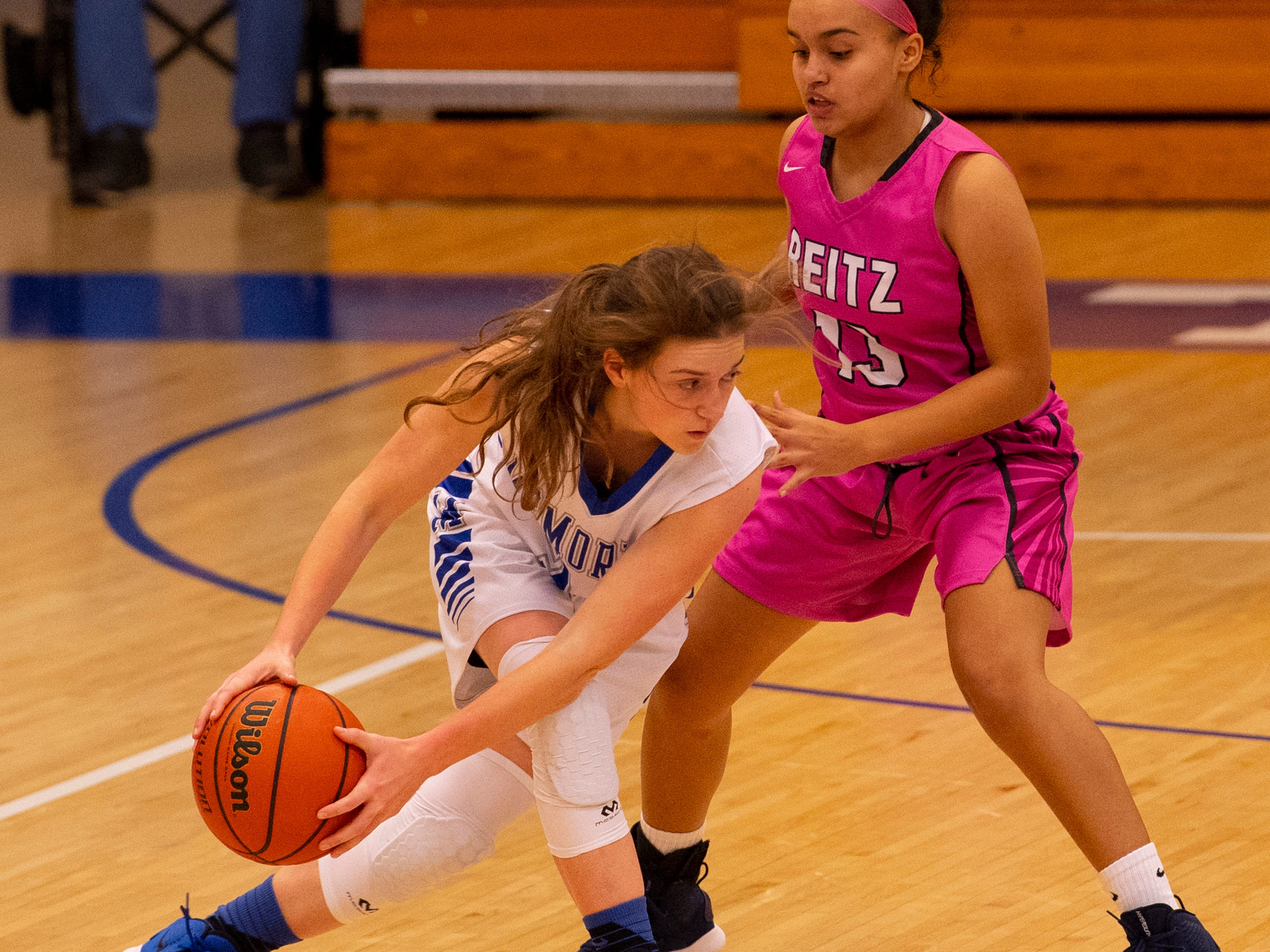 Memorial's  Soffia Rieckers (31) is guarded by Reitz's Kyla Terry (13) in the first round of the SIAC Tournament at Memorial High School Tuesday night.