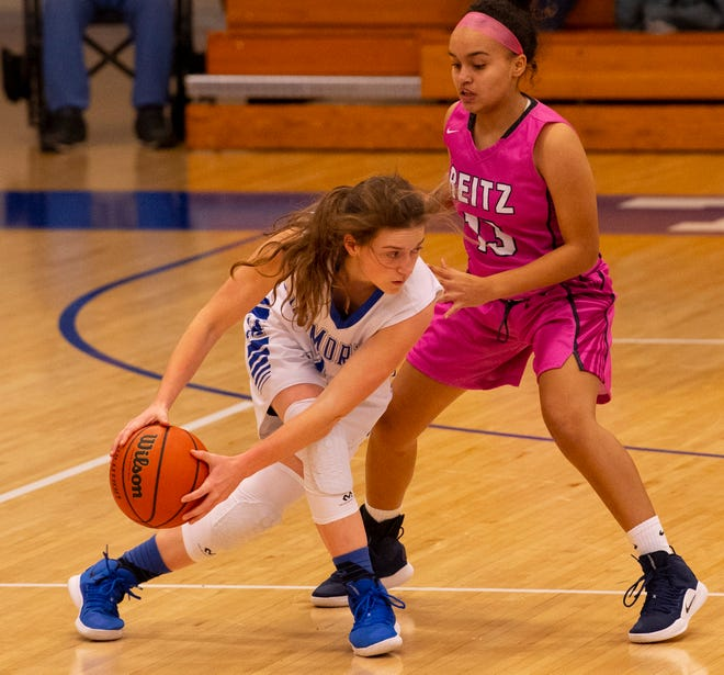 Memorial's Soffia Rieckers (31) is guarded by a Reitz defender in the first round of the SIAC Tournament. The Tigers advanced to the championship with a win over Mater Dei.
