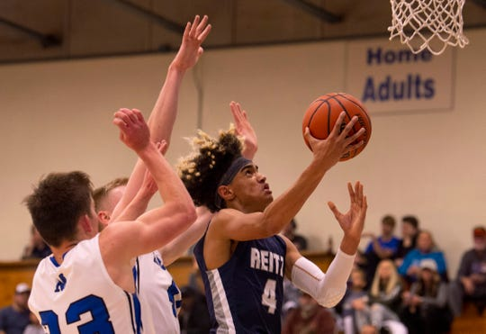 Reitz's Khristian Lander (4) shoots around Memorial's defense in the first round of the SIAC Tournament.