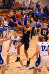 Reitz's Owen Dease (12) goes for two points against Memorial in the first round of the SIAC Tournament at Memorial High School Tuesday night.