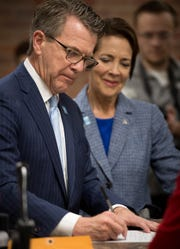 Evansville Mayor Lloyd Winnecke with his wife Carol McClintock by his side fills out re-election papers at the Vanderburgh County Election Office Wednesday, January 9, 2019.