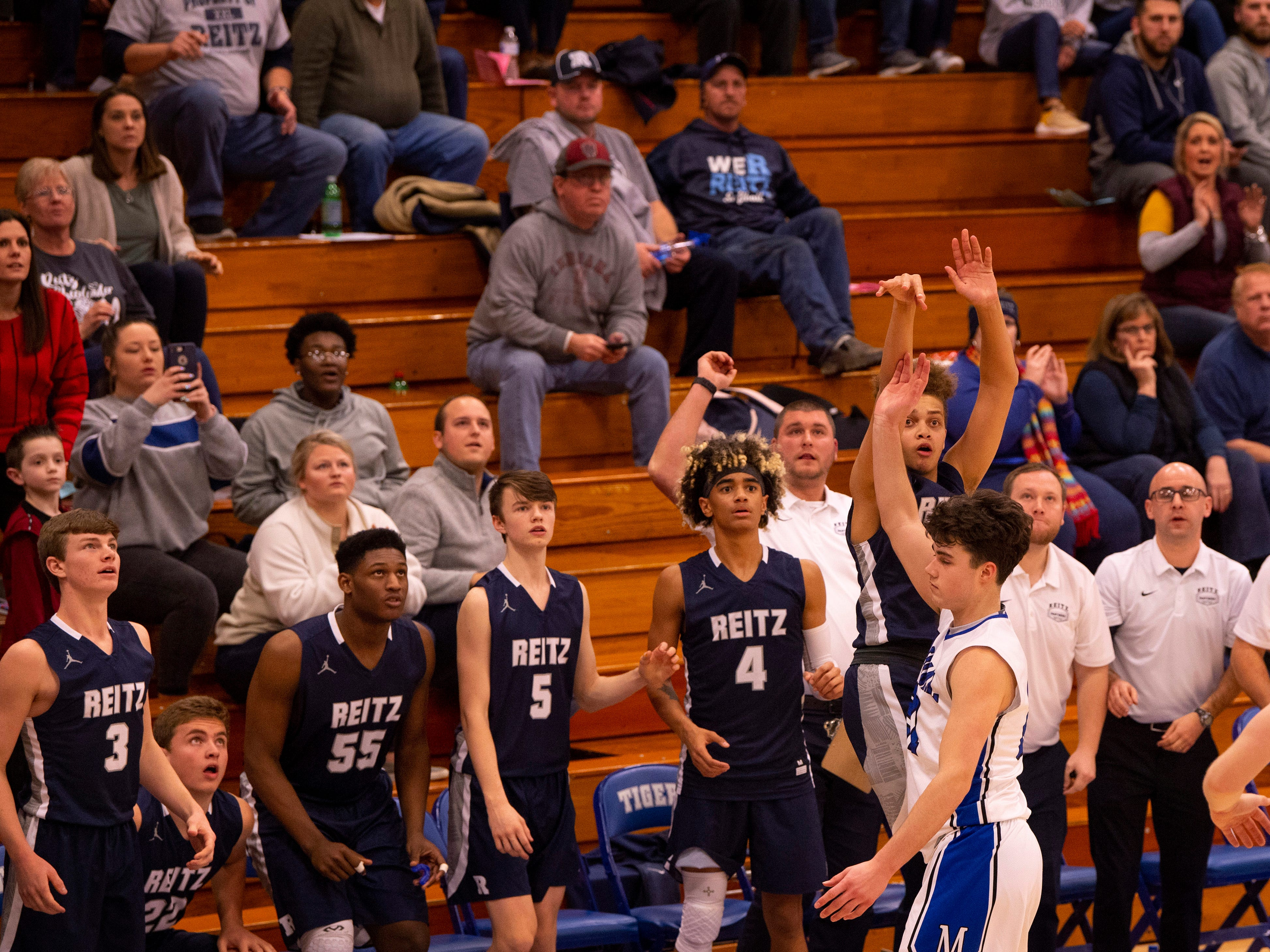 The Reitz bench was the last-second three-pointer attempt by Reitz's Owen Dease(12) against Memorial in the first round of the SIAC Tournament at Memorial High School Tuesday night. Memorial beat Reitz 56-54.