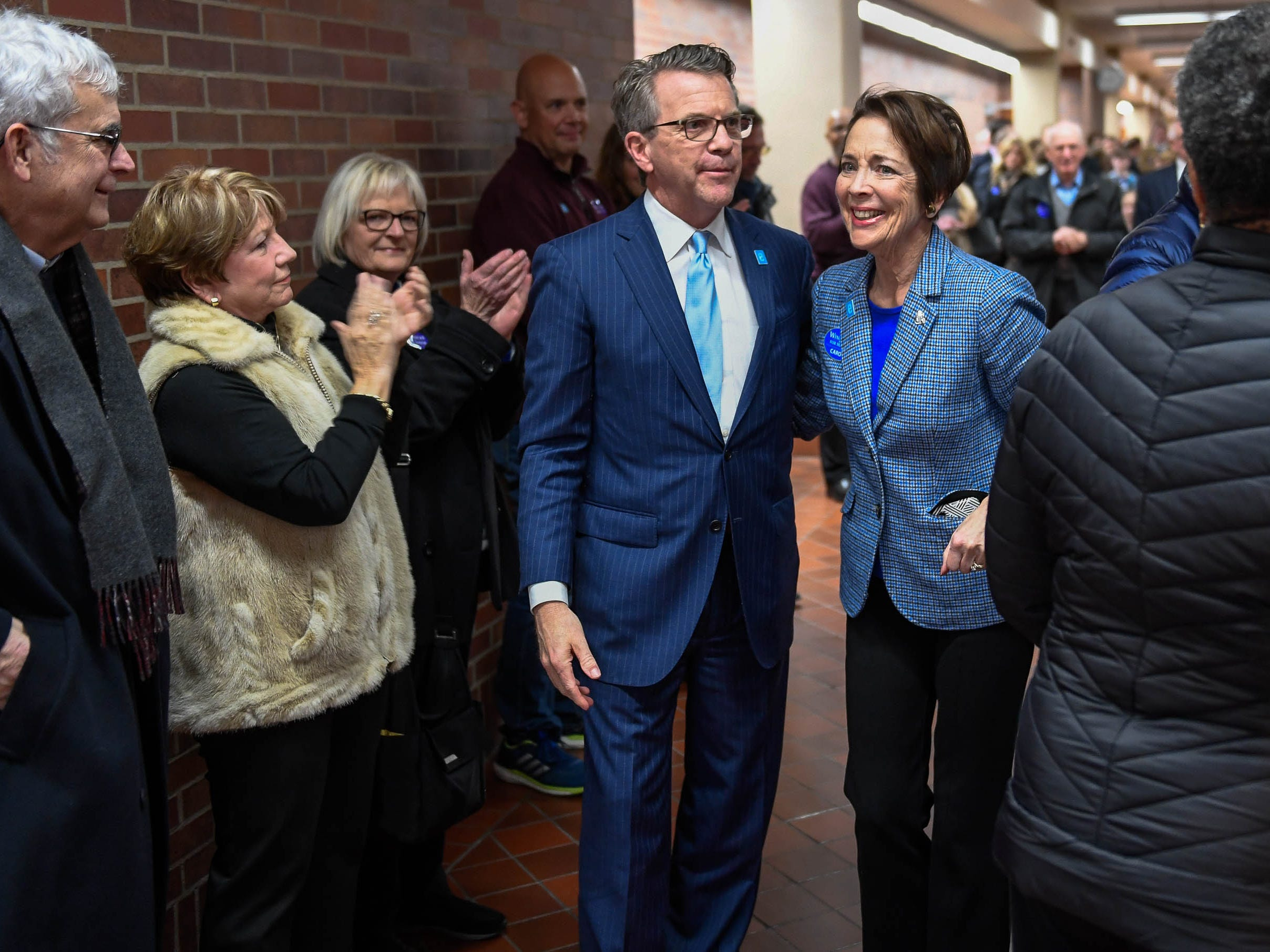 Evansville Mayor Lloyd Winnecke and his wife Carol McClintock make their way through a gauntlet of supporters as he files for re-election at the Vanderburgh County Election Office Wednesday, January 9, 2019.